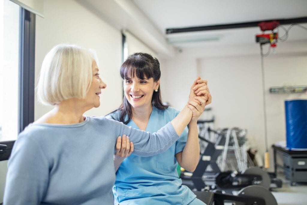 A patient receiving care from a physical therapist.