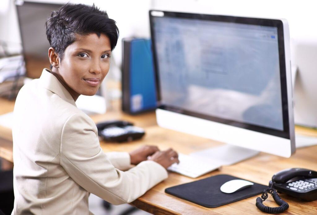 Billing professional on her desktop taking advantage of electronic data interchange or EDI.