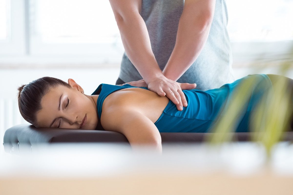 A patient receiving treatment from a chiropractor.