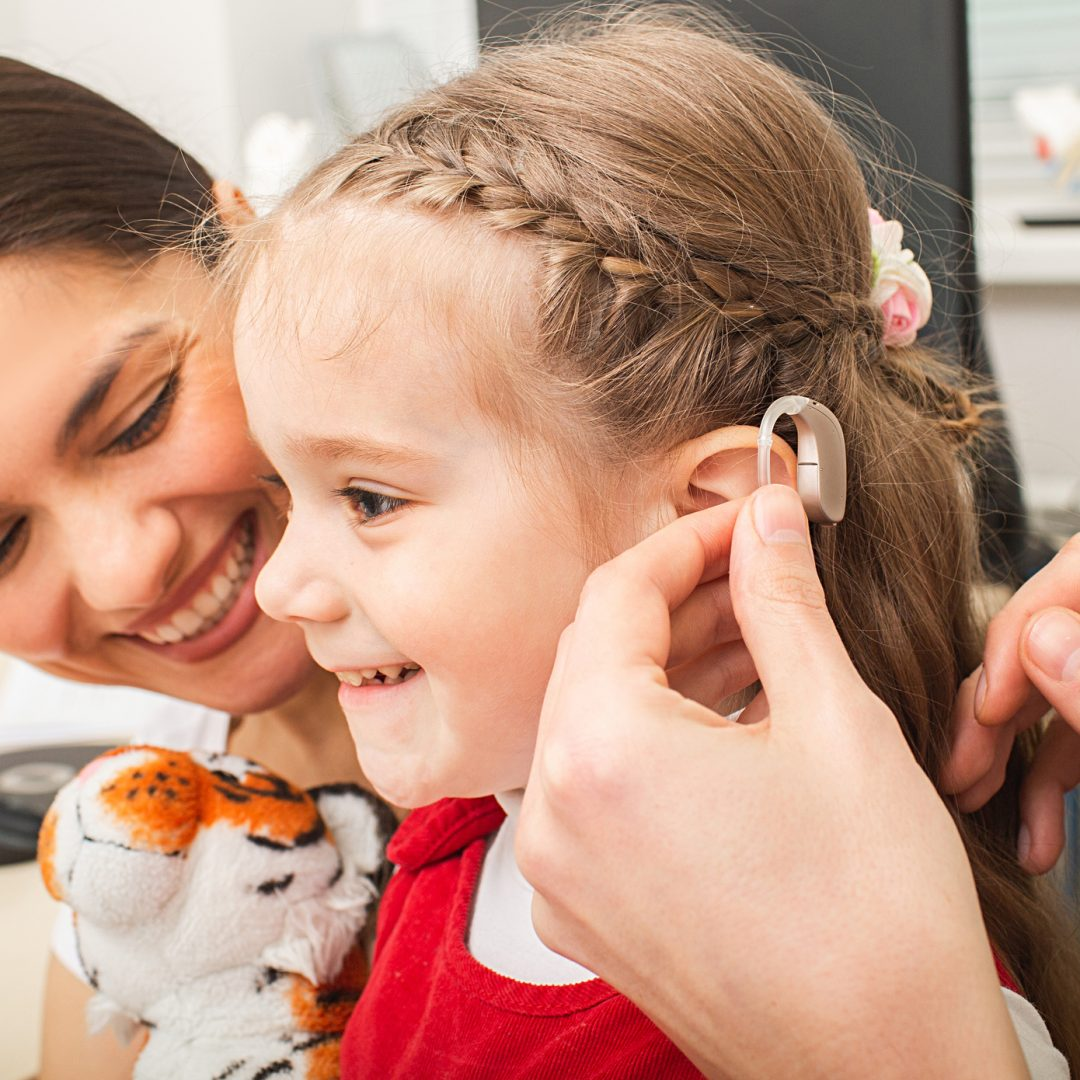 Audiologist with pediatric patient.