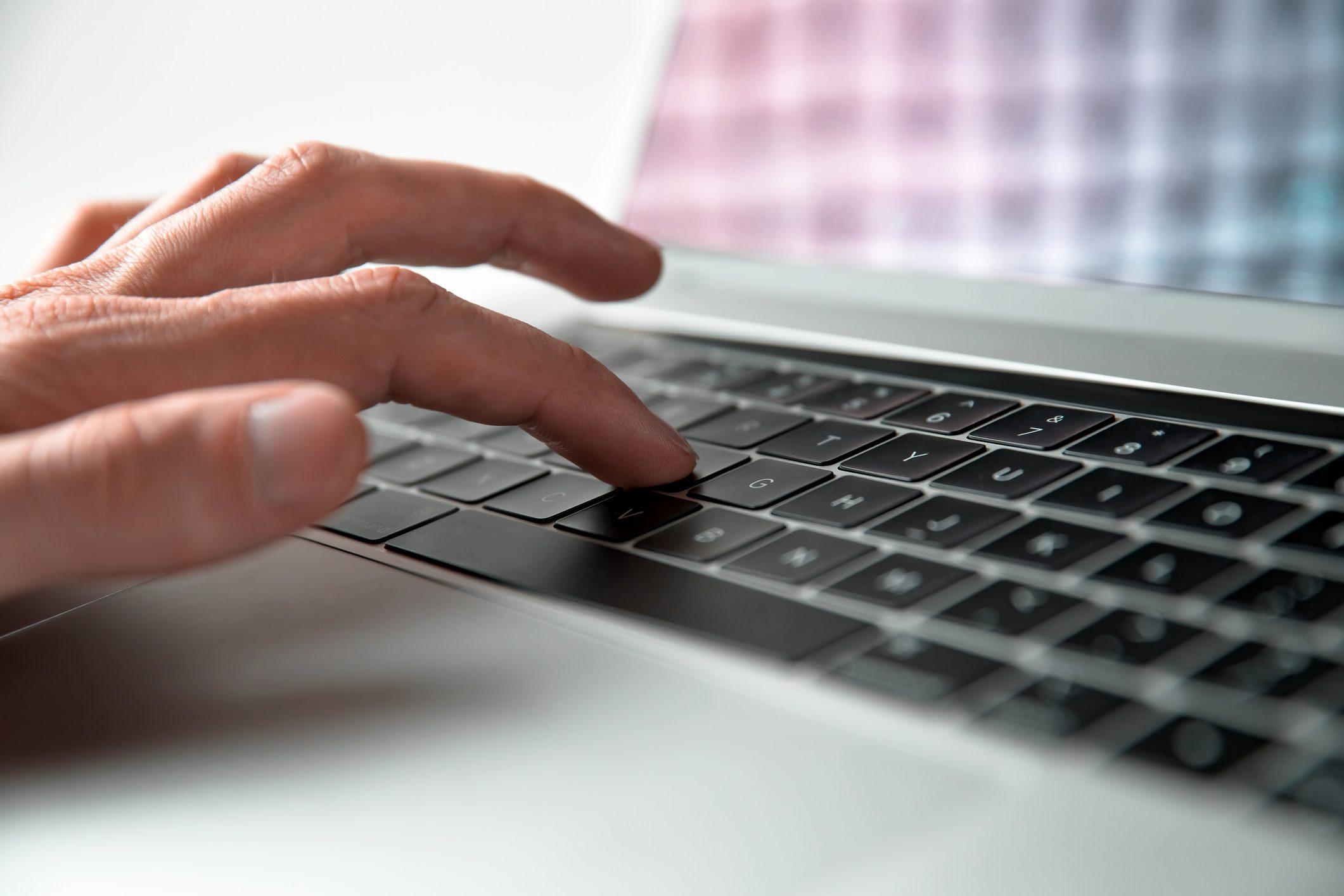 close up. man using a keyboard shortcut on a laptop keyboard
